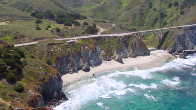 WS AERIAL View of Pacific Coast Highway and Bixby Bridge / California, United States