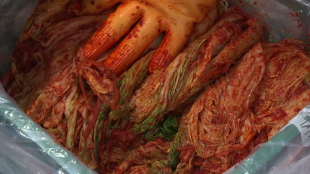 View of packing Kimchi at Kimchi factory (Popular traditional fermented Korean side dish)