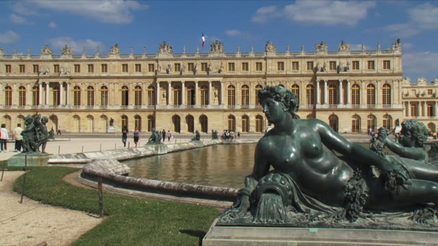 ws view of palace exterior with statue in foreground / versailles, ile de france, france - palace stock videos & royalty-free footage