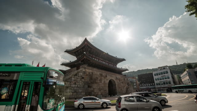 view of paldalmun(korea treasure 402) and passing cars on the road in suwon hwaseong (unesco world heritage sites) - hwaseong palace stock videos and b-roll footage