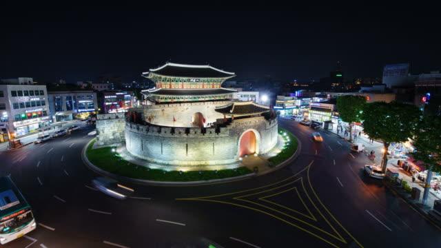 ws t/l view of paldalmun gate at night (unesco world heritage) / suwon, gyeonggi do, south korea  - hwaseong palace stock videos and b-roll footage