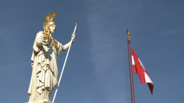 ws view of pallas athene statue and flag at austrian parliament / vienna, austria - traditionally austrian stock videos & royalty-free footage