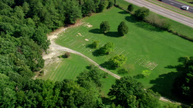 ws aerial zo zi view of pamplin historical park cemetery / virginia, united states - religious equipment stock videos & royalty-free footage