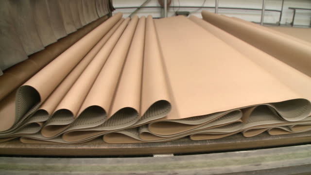 cu view of paper at corrugated paper mill / werne, north rhine westphalia, germany - paper mill stock videos & royalty-free footage