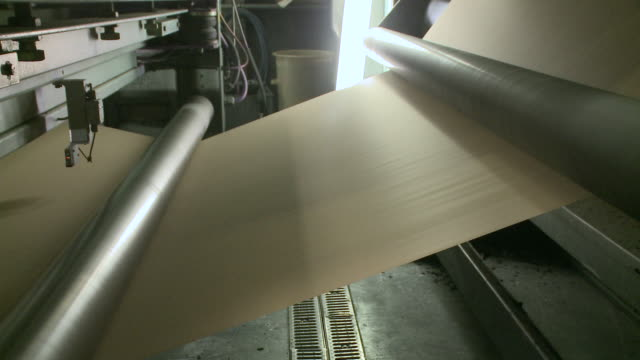 cu view of paper at corrugated paper mill / werne, north rhine westphalia, germany - paper mill stock videos and b-roll footage
