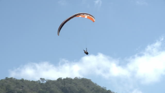 WS TS View of paraglider landing near beach / Yelapa, Jalisco, Mexico