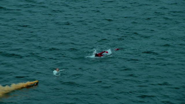 WS AERIAL ZI View of paramedic swimming towards man in sea / Cape Town, Western Cape, South Africa
