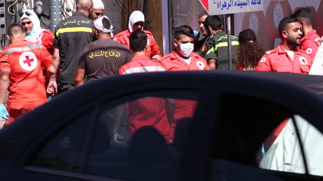 view of paramedics and lebanese red cross personnel standing around an unconscious bloodied shia man on a stretcher the injured man was taking part... - ashura muharram stock videos & royalty-free footage