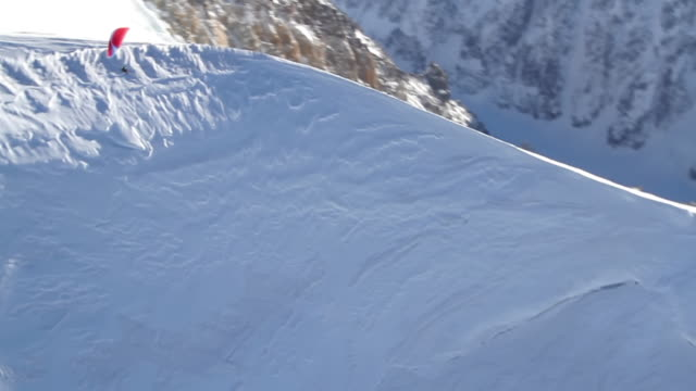 ws aerial ts view of paramotor flying over the summit of the mont blanc / chamonix, haut savoir, france  - gliding stock videos and b-roll footage