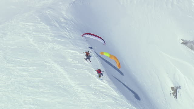 ws aerial zi ts view of parasail skiing / switzerland - hang gliding stock videos and b-roll footage