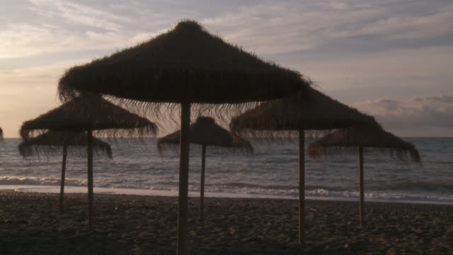 ms view of parasol at beach / marbella, andalusia, spain        - palapa stock videos & royalty-free footage