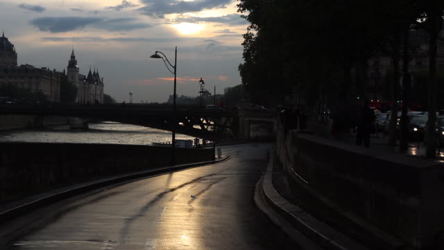 view of paris, against the light, banks of the seine - flussufer stock-videos und b-roll-filmmaterial