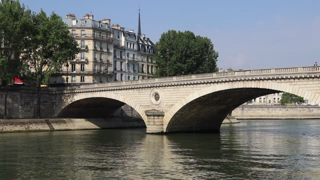 view of paris, bridge over the seine - brücke stock-videos und b-roll-filmmaterial