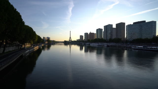 view of paris skyline and river seine at dawn - river seine stock videos & royalty-free footage
