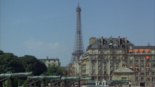 ms pan view of paris with old fort and guns, older apartment buildings in front of eiffel tower - 1978 stock videos and b-roll footage