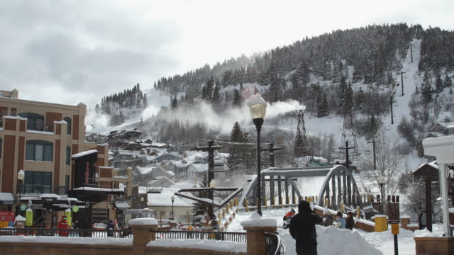 view of park city during winter with snow making machines on - park city utah video stock e b–roll
