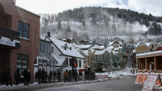 view of park city with snow making machines over the houses - park city utah video stock e b–roll