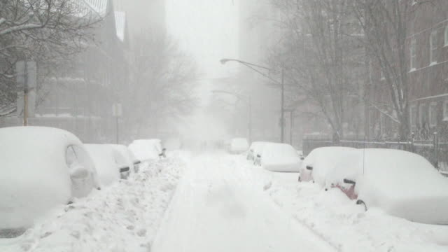 ws view of parked cars covered in snow during blizzard / chicago, illinois, usa - snow storm stock videos and b-roll footage