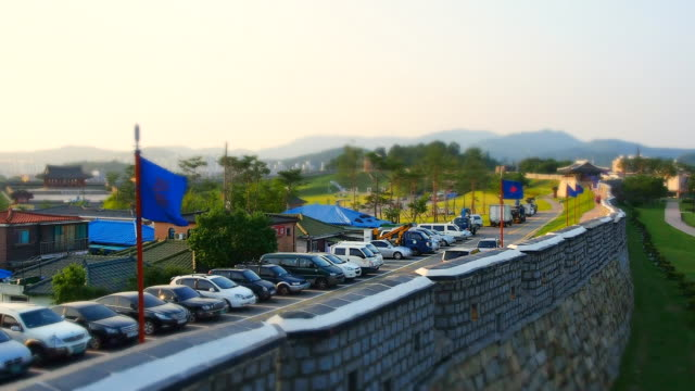 ws t/l view of parking cars at fortified wall of changnyongmun gate in suwon hwaseong castle (unesco) / suwon, gyeonggi-do, south korea - hwaseong palace stock videos and b-roll footage