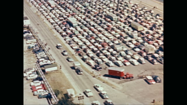 ws aerial pov view of parking lot with sea in background / united states - trucks in a row stock videos & royalty-free footage