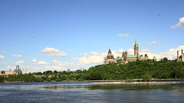 view of parliament from ottawa river - ottawa stock videos & royalty-free footage
