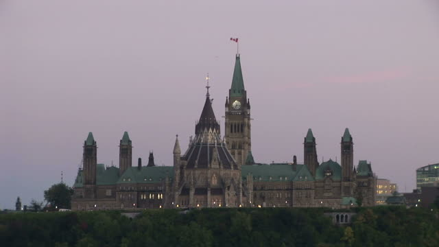 view of parliament hill at magic hour in ottawa canada - parliament hill ottawa stock videos and b-roll footage