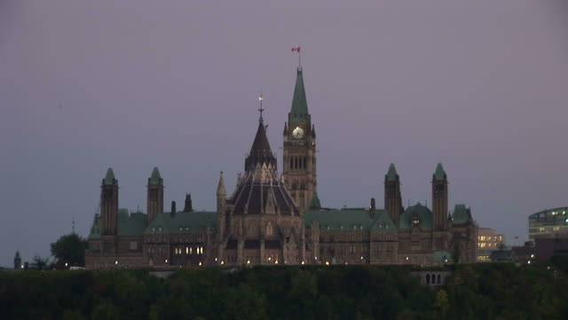 view of parliament hill at magic hour in ottawa canada - parliament hill stock videos & royalty-free footage