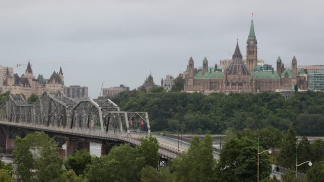 view of parliament hill from ottawa river, canada - quebec stock videos & royalty-free footage