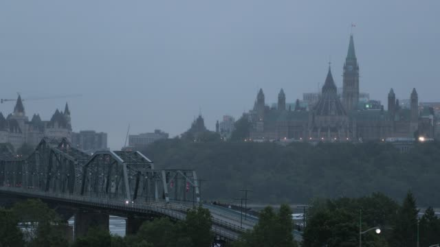view of parliament hill from ottawa river, canada - traditionally canadian stock videos & royalty-free footage