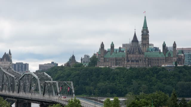view of parliament hill from ottawa river, canada - ontario canada stock videos and b-roll footage