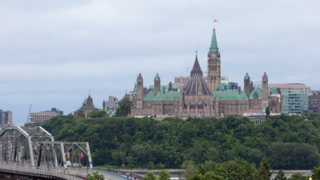 view of parliament hill from ottawa river, canada - ottawa stock videos & royalty-free footage