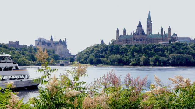 view of parliament hill from ottawa river, canada - tourboat stock videos & royalty-free footage