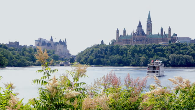 view of parliament hill from ottawa river, canada - ottawa stock videos and b-roll footage