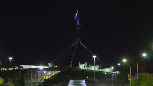 ws t/l zo view of parliament house with traffic along avenue at night / canberra, australian capital territory, australia - canberra stock videos and b-roll footage