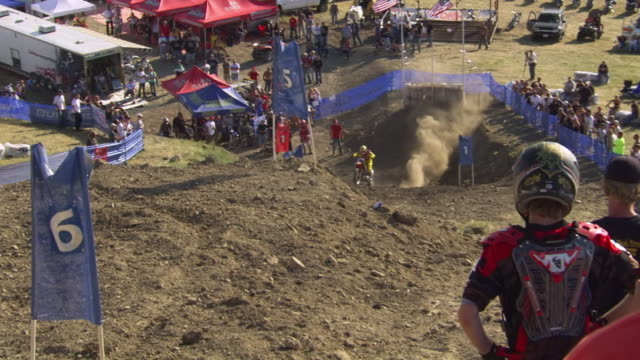 WS TS View of participant climbing hill in Pro Hill climb motocross event during Sturgis Motorcycle Rally / Sturgis, South Dakota, United States