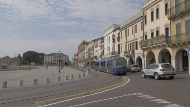 view of passing city tram in prato della valle, padua, veneto, italy, europe - prato stock videos and b-roll footage