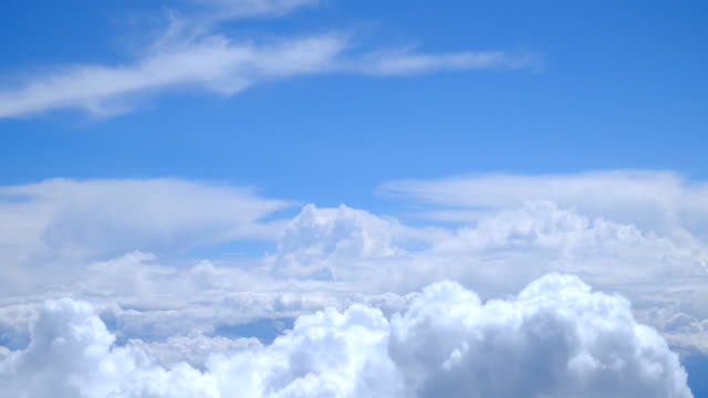 view of passing clouds from an airplane window - moving past stock videos & royalty-free footage