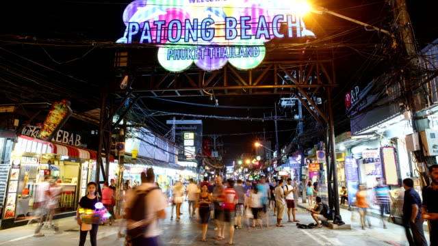 view of patong beach welcome sign and people walking on bangla street at night - phuket stock videos & royalty-free footage