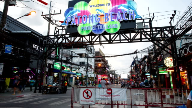 View of Patong Beach welcome sign and people walking on Bangla Street