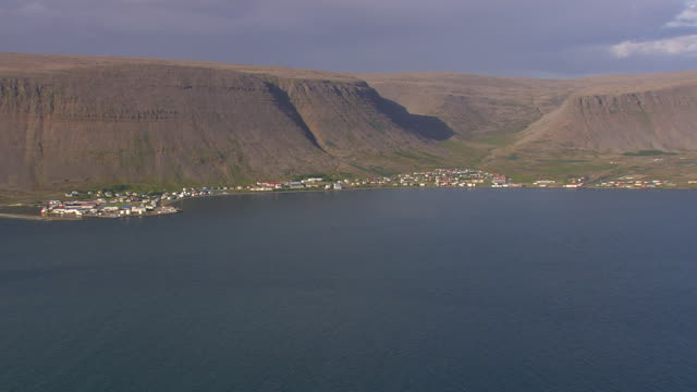 WS AERIAL View of Patreksfjordur village near mountain and bay / Iceland