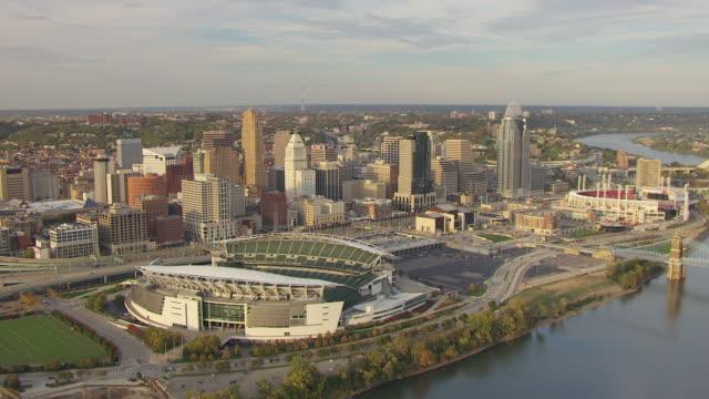 WS AERIAL View of Paul Brown Football Stadium with downtown buildings / Cincinnati, Ohio, United States