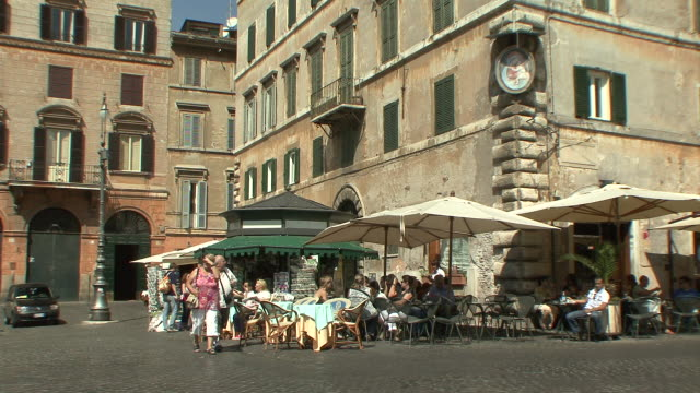 ws view of pavement café at corner of piazza farnese / rome, italy  - town square stock videos and b-roll footage