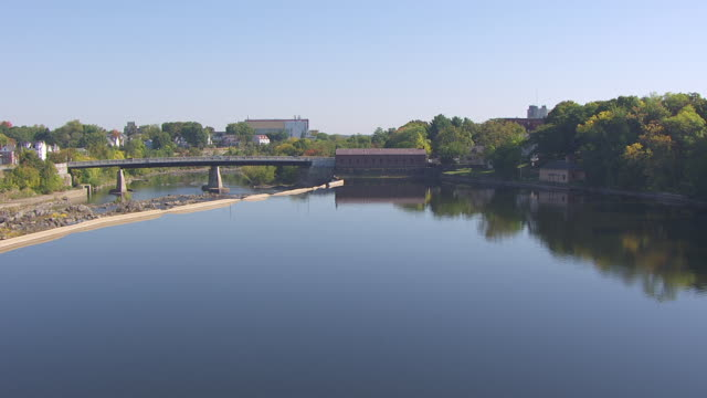 ws aerial pov view of pawtucket falls, canal and merrimack river / lowell, massachusetts, united states - lowell stock videos & royalty-free footage