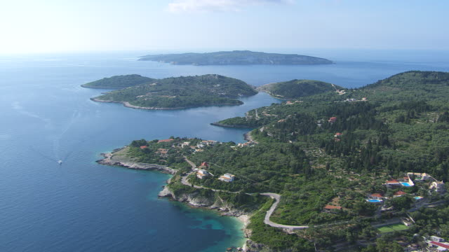 ws aerial view of paxi and antipaxi with houses and ocean coast / corfu, ionian islands, greece - island stock videos and b-roll footage