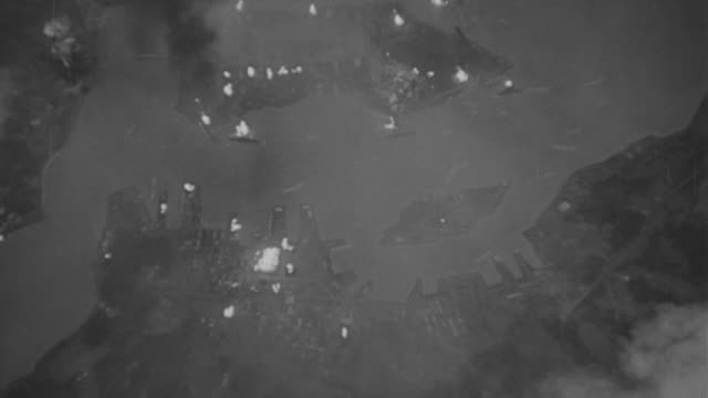 aerial view of pearl harbor at night after attack lots of fires below - isole del pacifico video stock e b–roll