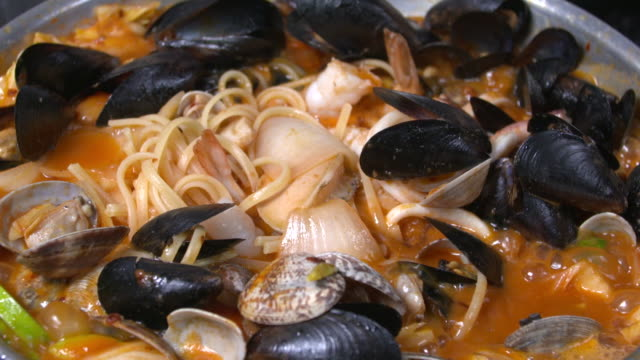 view of pecher pasta(seafood tomato stew with pasta) being boiled on a pot - clam seafood stock videos and b-roll footage