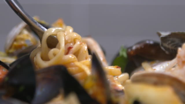 view of pecher pasta (seafood tomato stew with pasta) being twirled onto fork - seafood stock videos & royalty-free footage