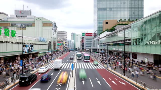 View of pedestrian crossing by shopping mall and Shinjuku JR station at daytime in Shinjuku, Tokyo, Japan