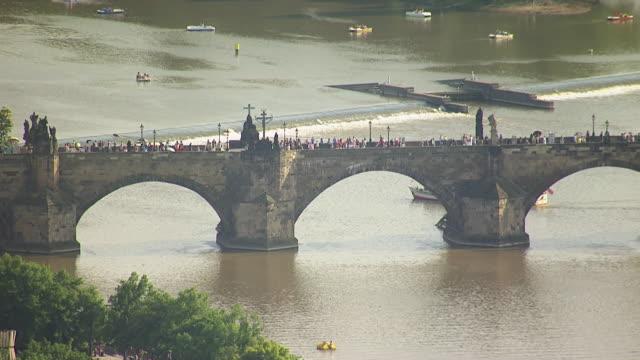 ws aerial view of pedestrian walking bridge over vitava river / prague, czech republic - prag stock-videos und b-roll-filmmaterial