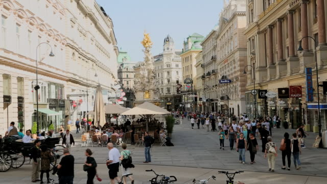 WS View of Pedestrians Graben Street people strolling past old town buildings and shops / Vienna, Austria